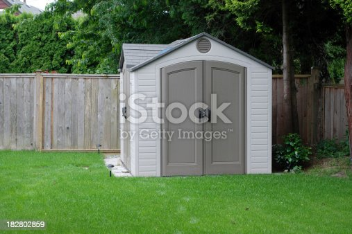 A small shed in a residential backyard.  See also