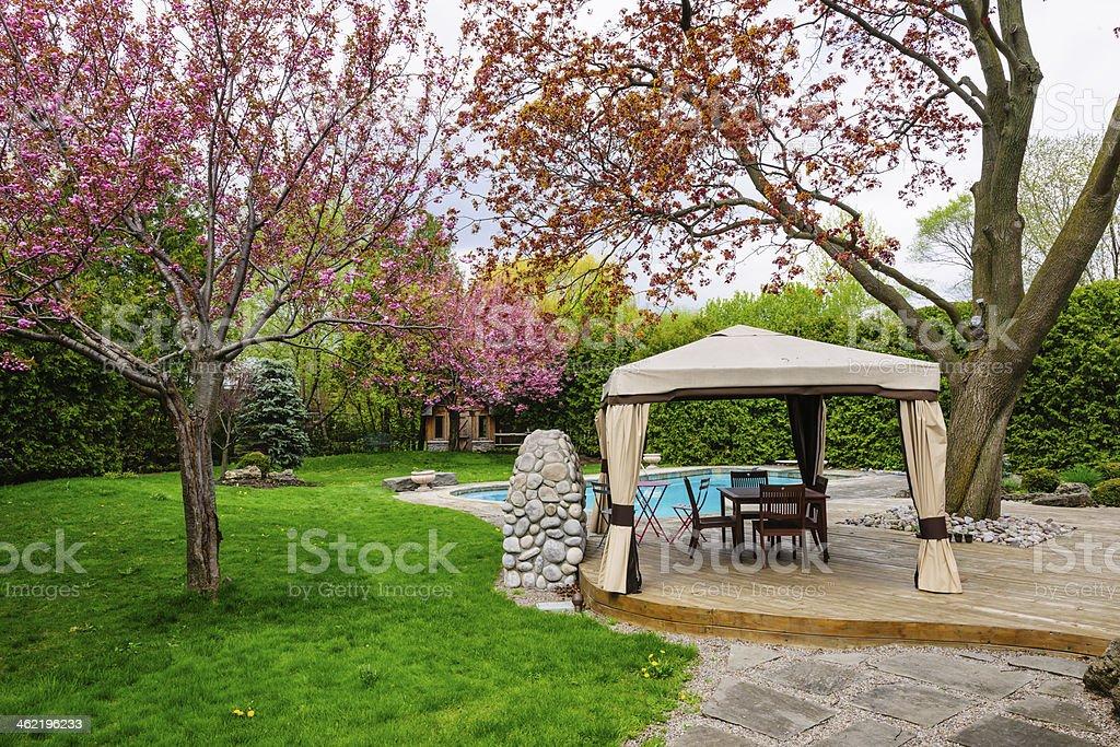 Backyard with gazebo and deck stock photo