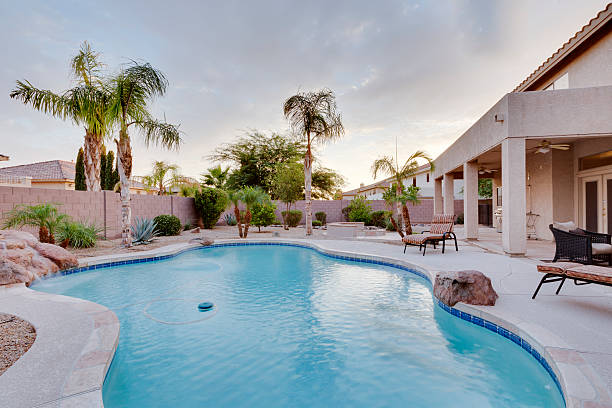 A backyard with pool at a desert home stock photo