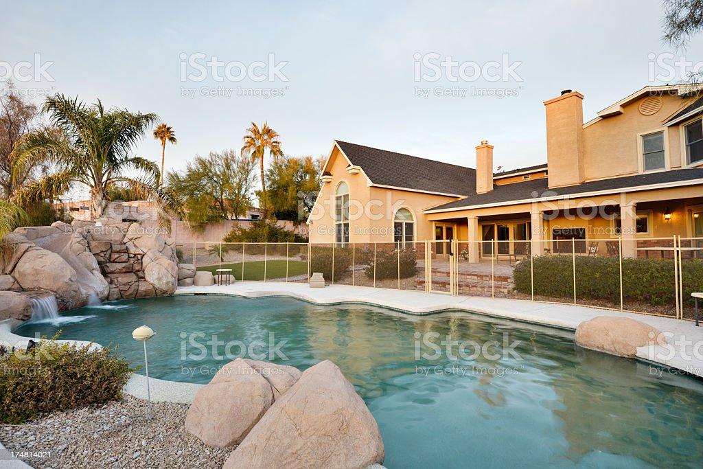 Backyard with rocks and swimming nag pool stock photo