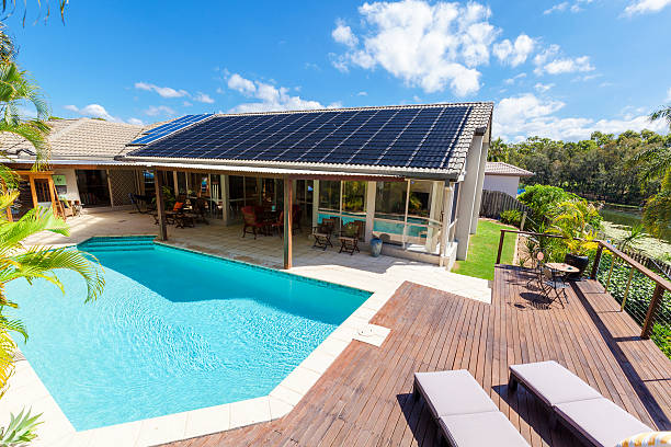 backyard with swimming pool - zonne energie stockfoto's en -beelden