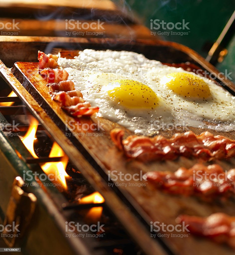 Bacon & Eggs on Old Camp Stove stock photo