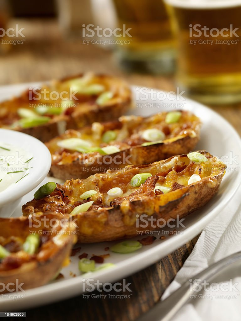 Bacon and Cheddar Stuffed Potato Skins royalty-free stock photo