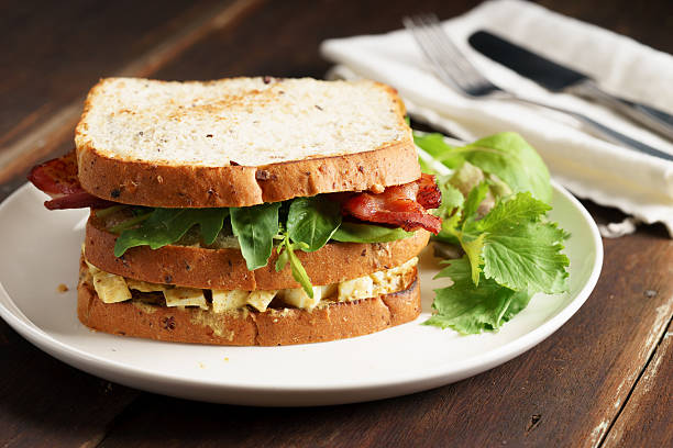 bacon and egg salad sandwich - club sandwich stock photos and pictures