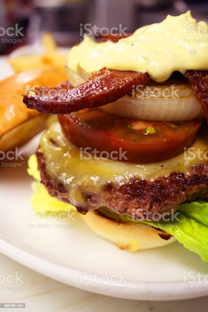 Bacon and Grilled Onion Cheeseburger with Homemade Aioli stock photo