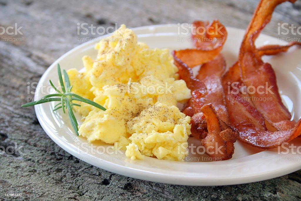 Bacon and scrambled eggs on a plate  stock photo