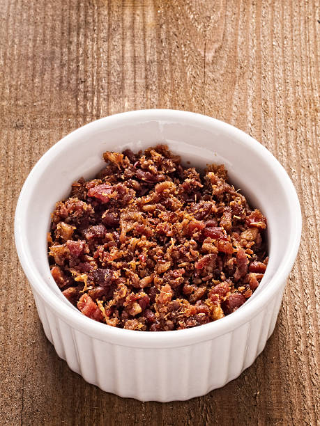 bacon bits - horse bit stock photos and pictures
