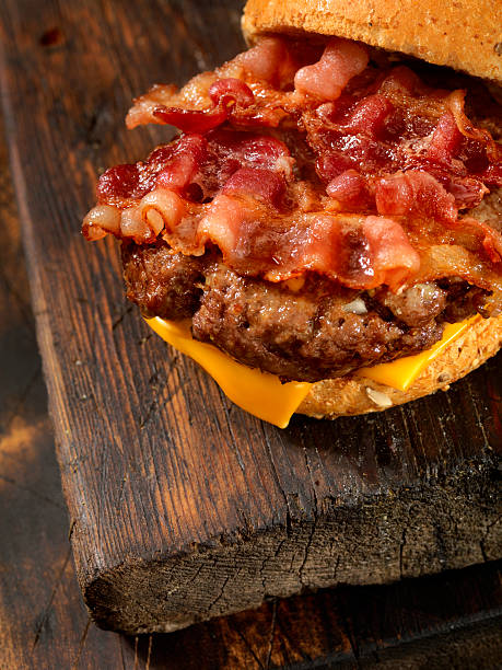 Bacon Cheese Burger Bacon Cheese Burger -Photographed on Hasselblad H3D-39mb Camera bacon cheeseburger stock pictures, royalty-free photos & images
