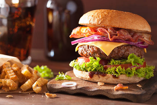 bacon cheese burger with beef patty tomato onion stock photo