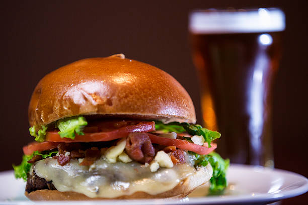 Bacon cheeseburger and a draft beer . Bacon cheeseburger and a draft beer . bacon cheeseburger stock pictures, royalty-free photos & images