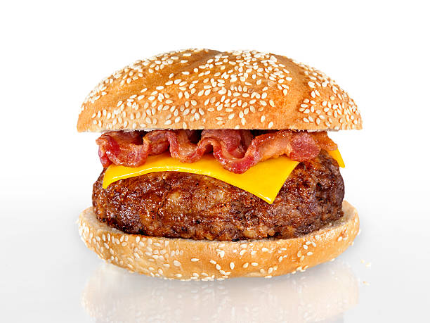 Bacon Cheeseburger Bacon Cheeseburger with Natural Shadow and Gradation-Photographed on Hasselblad H3D-39mb Camera bacon cheeseburger stock pictures, royalty-free photos & images