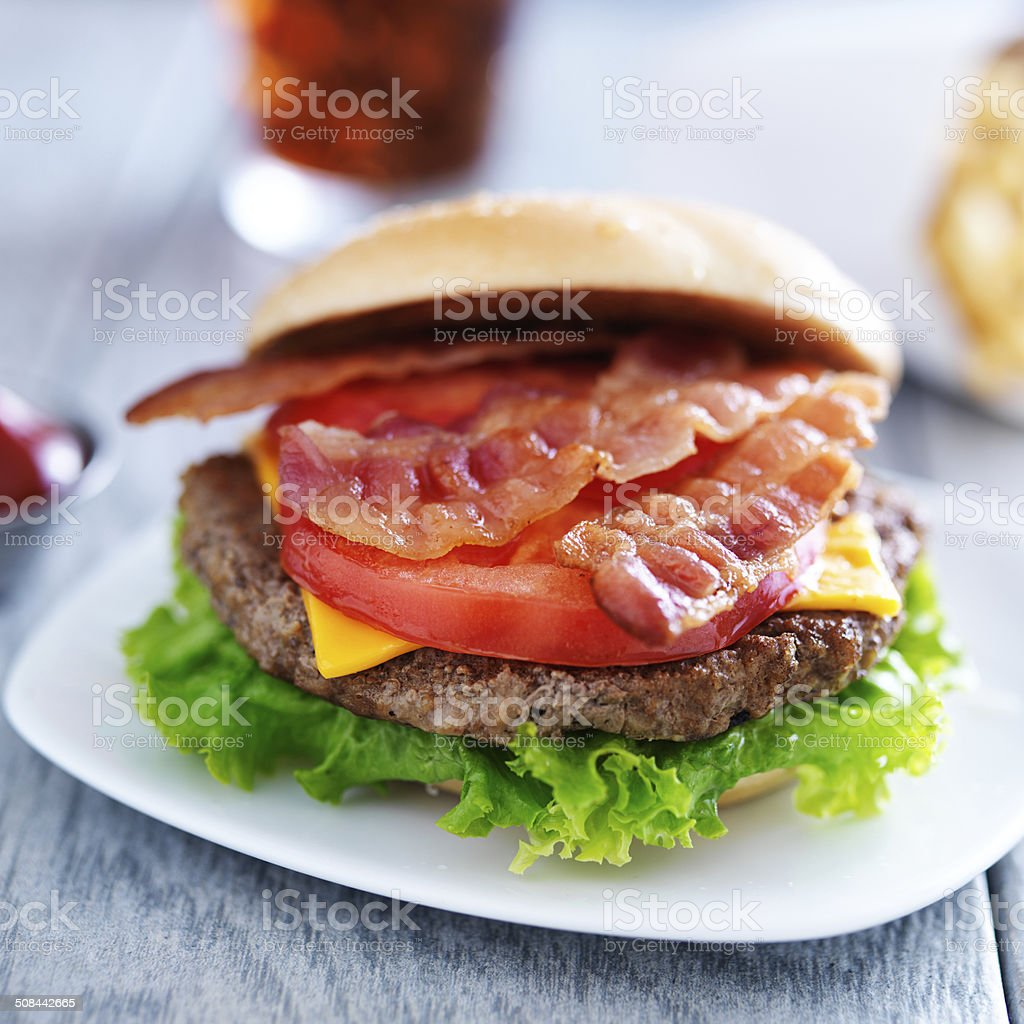 bacon chesseburger with fries and cola close up stock photo