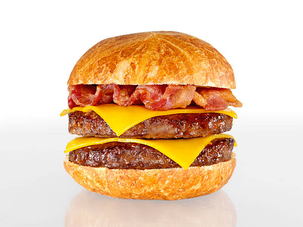 Bacon Double Cheeseburger Bacon Double Cheeseburger with Natural Shadow and Gradation-Photographed on Hasselblad H3D-39mb Camera bacon cheeseburger stock pictures, royalty-free photos & images