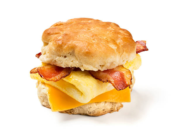 Bacon Egg & Cheese Biscuit Bacon, egg, and cheese biscuit on white background.  Please see my portfolio for other food and drink images. biscuit stock pictures, royalty-free photos & images