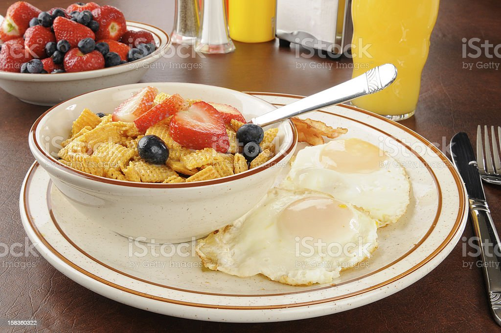Bacon, eggs and cold cereal royalty-free stock photo