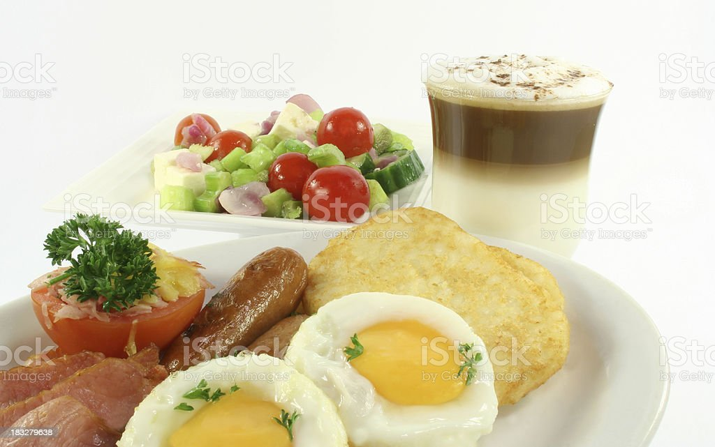 bacon, eggs, hash browns, tomato, sausages, salad and coffee latte royalty-free stock photo