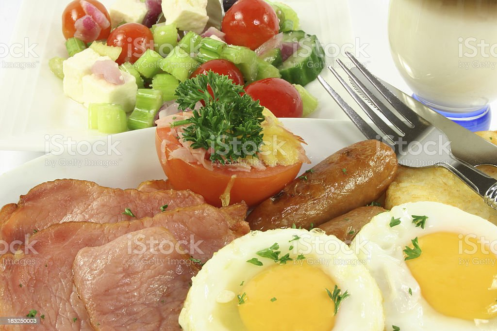 bacon, eggs, tomato, sausages and salad royalty-free stock photo