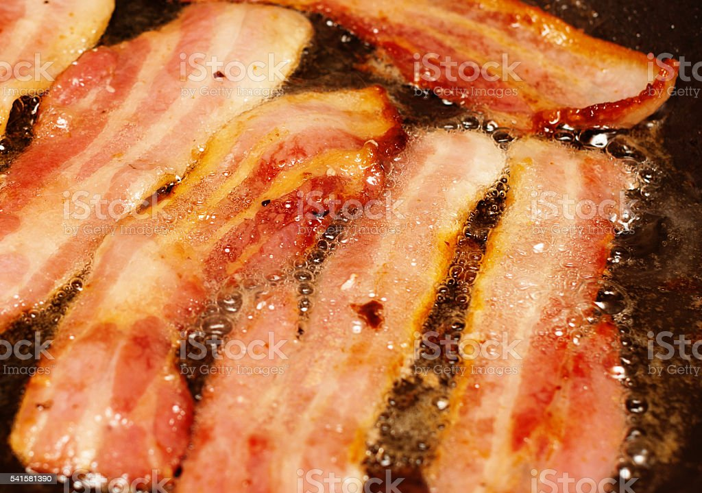 Bacon frying, delicious, paleo breakfast, high fat low carb, pork, stock photo