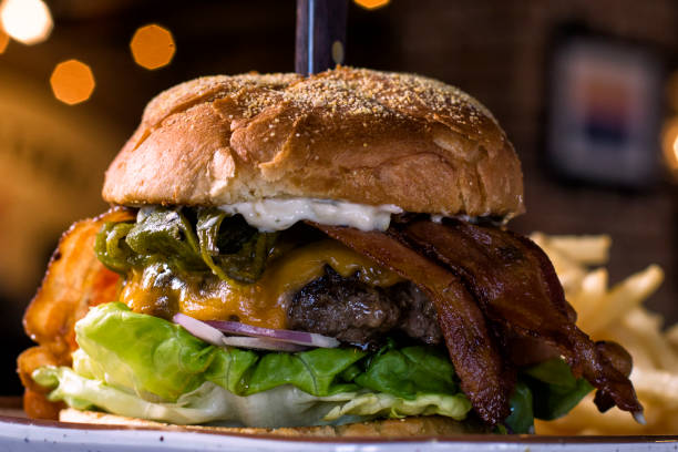 bacon green chile burger - green chilli pepper stock photos and pictures