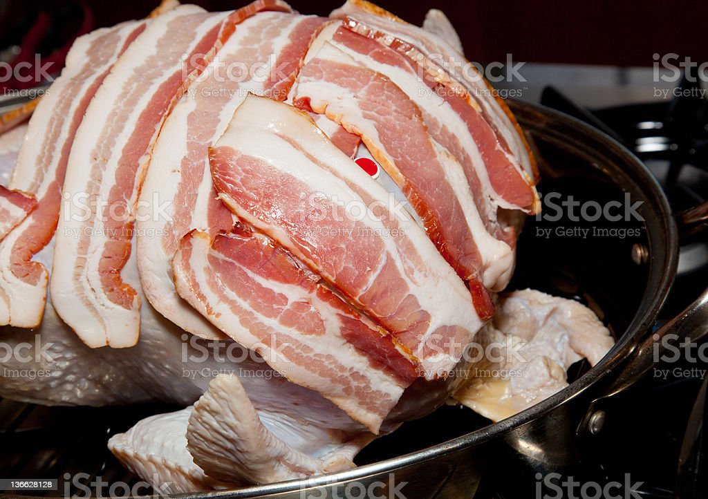 Bacon laid on turkey for roasting stock photo