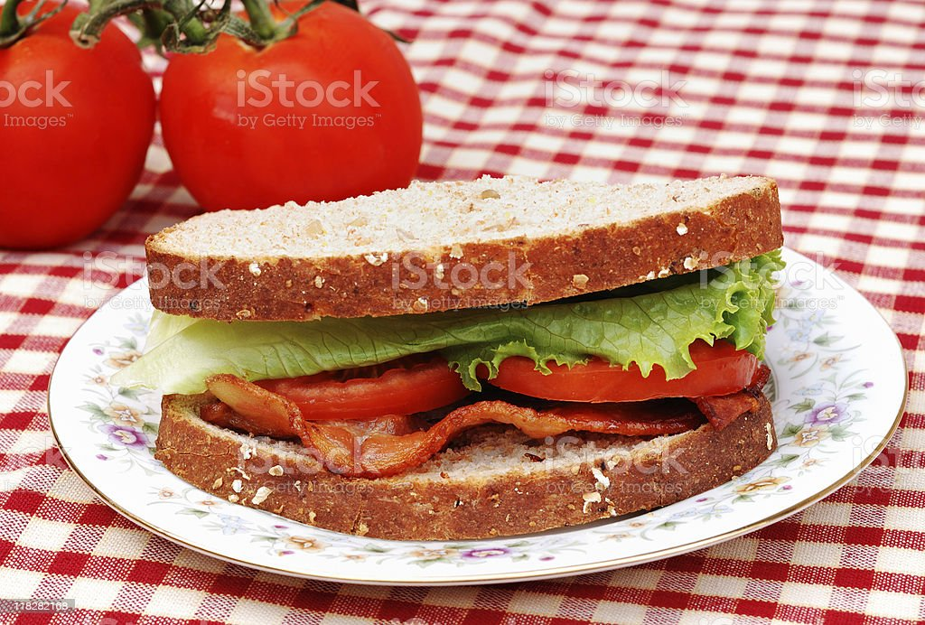 Bacon lettuce and tomato sandwich on plate royalty-free stock photo