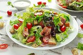 Bacon Lettuce Tomato, BLT salad with creamy dressing sauce, croutons.