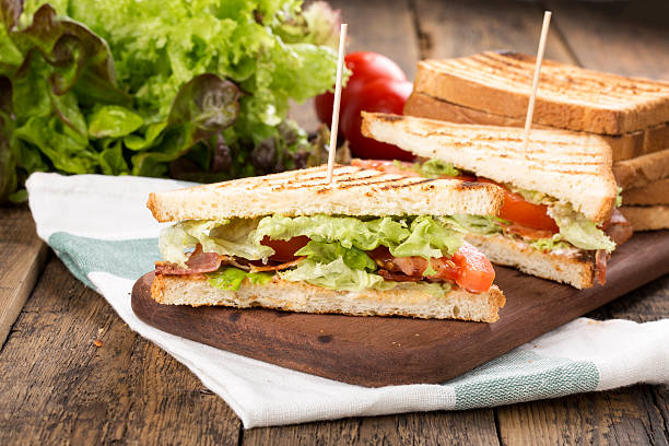 bacon lettuce tomato blt sandwich - club sandwich stock photos and pictures