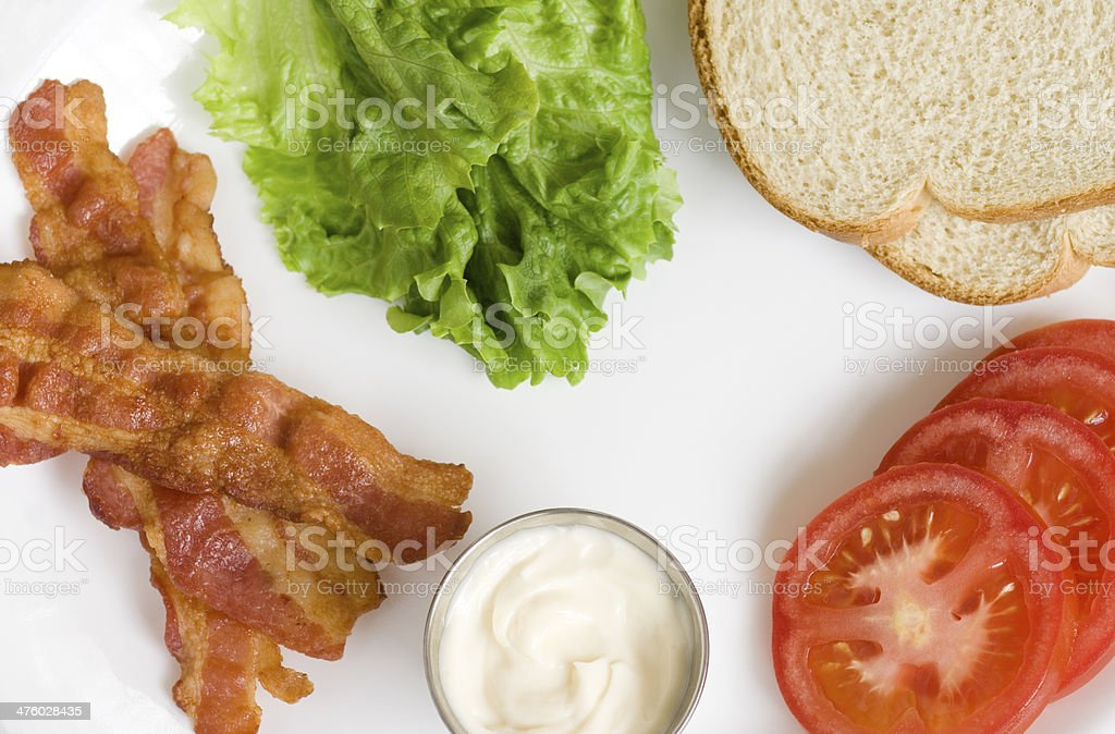 bacon lettuce tomato mayonnaise on platter stock photo