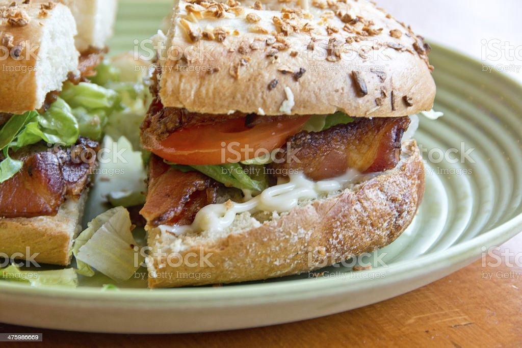 Bacon, lettuce, tomato (BLT) sandwich on a green plate stock photo