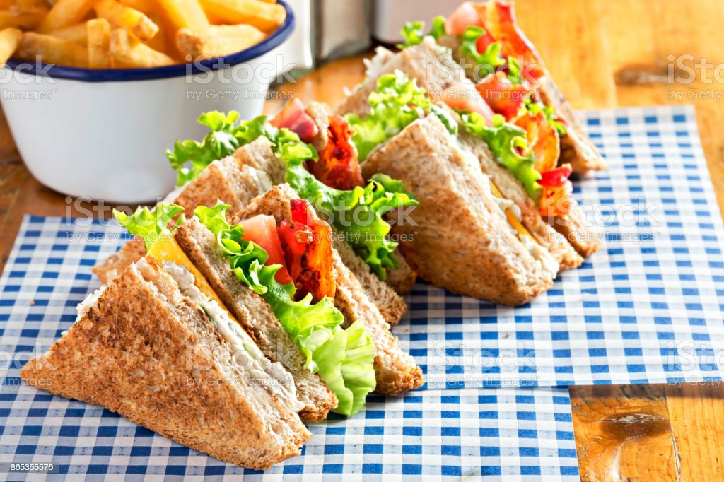 Bacon lettuce tomato sandwich with spring onion mayo and fries stock photo