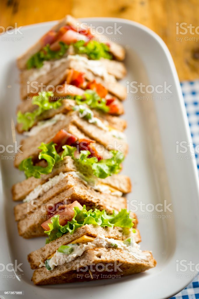 Bacon lettuce tomato sandwich with spring onion & mayo stock photo
