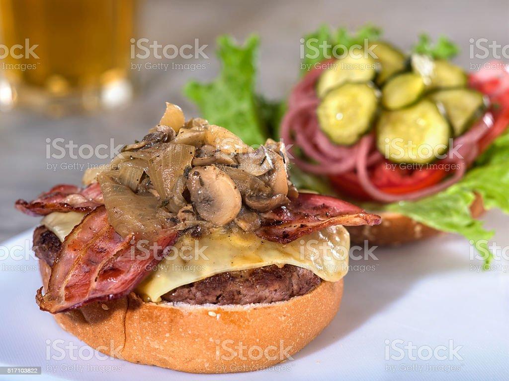 Bacon, mushroom and Swiss cheese burger stock photo