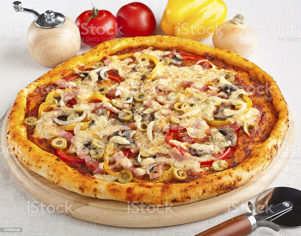 bacon, mushroom and vegetable pizza royalty-free stock photo
