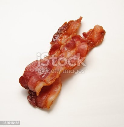 Two strips of hot bacon