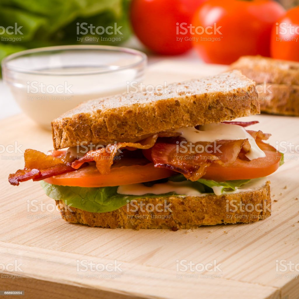 bacon sandwich on wooden table stock photo