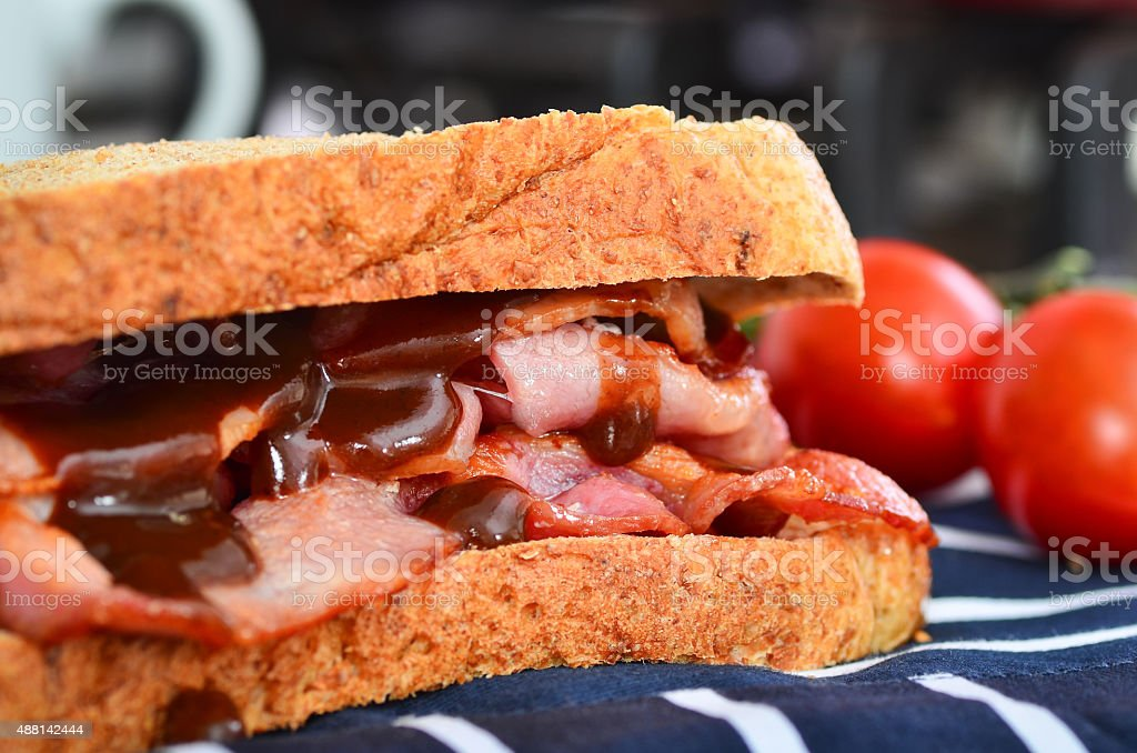 Bacon sandwich with brown sauce stock photo