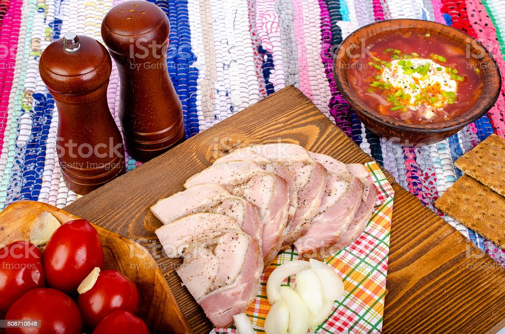 Bacon with bread, borscht and tomatoes. stock photo