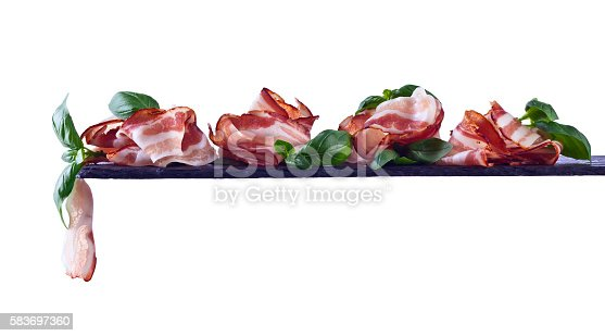 istock bacon with green basil 583697360