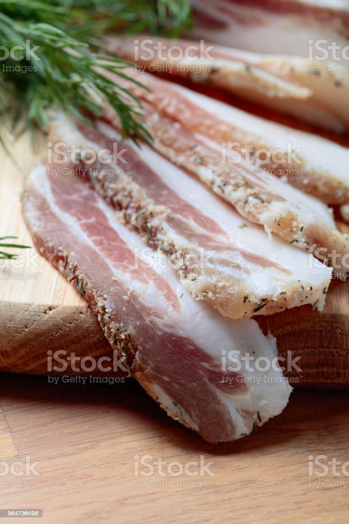 Bacon with spices . royalty-free stock photo