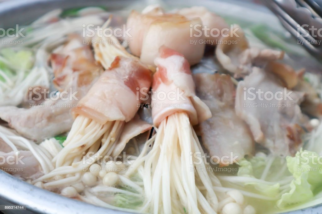 bacon wrapped enoki or bacon wrapped golden needle mushroom stock photo