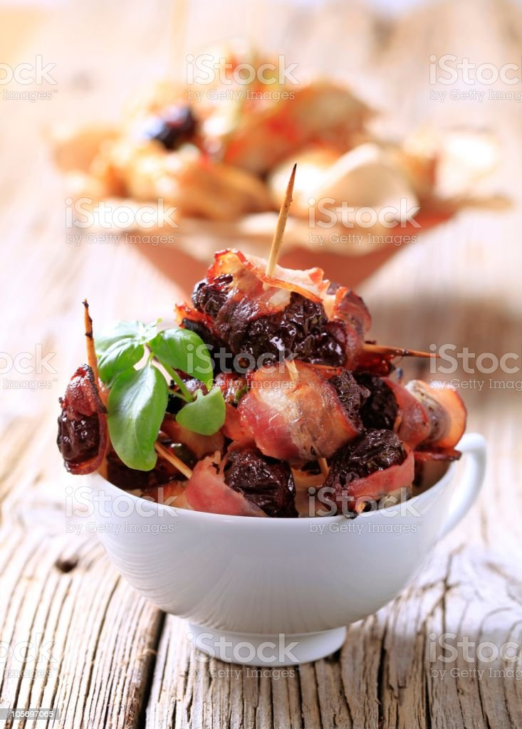 Bacon wrapped prunes royalty-free stock photo