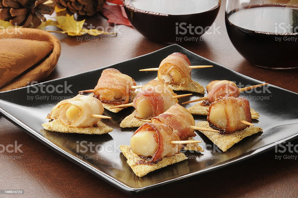 Bacon wrapped scallops appetizers stock photo