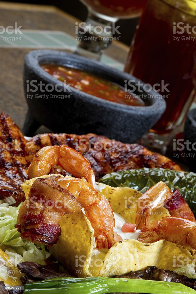 Bacon Wrapped Shrimp, Chicken and Skirt Steak, Mexican Style royalty-free stock photo