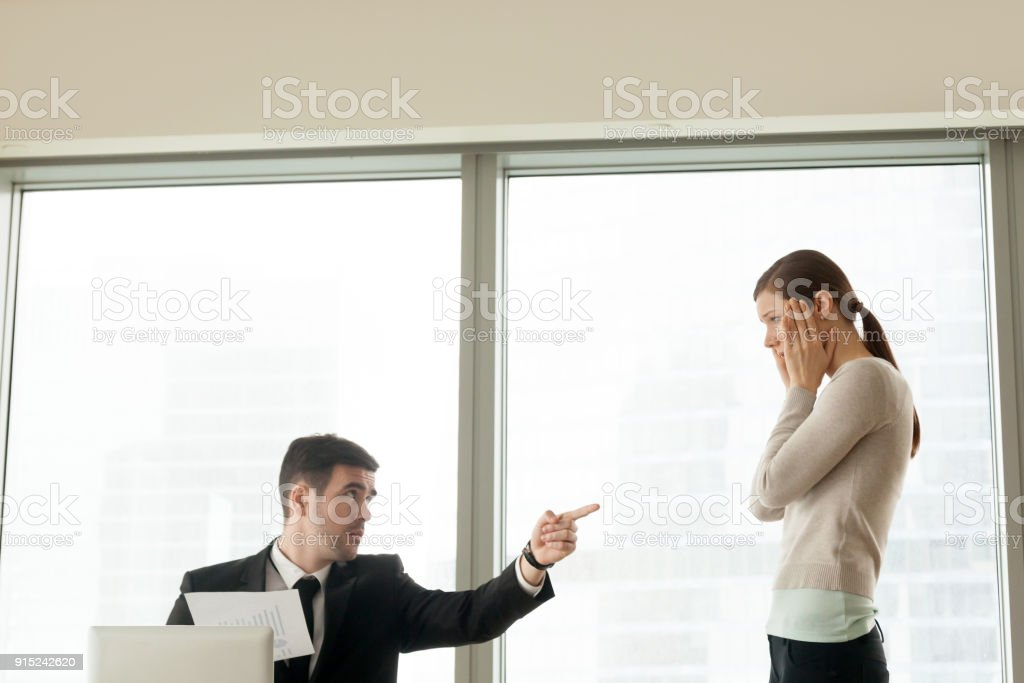 Bad boss firing dismissing incompetent employee, getting fired from job stock photo