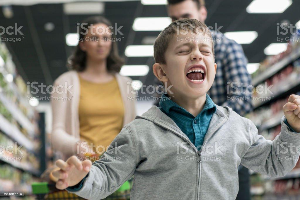 Bad boy in supermarket royalty-free stock photo