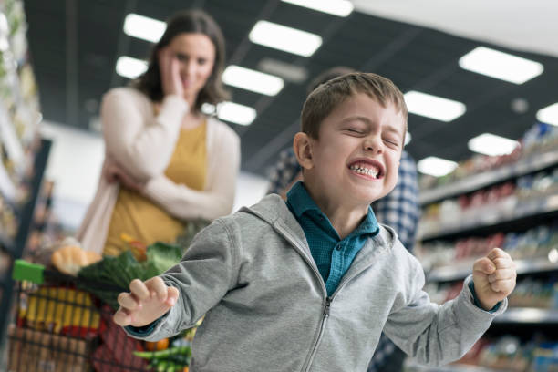 bad boy in supermarket - rudeness stock pictures, royalty-free photos & images