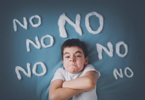 Bad boy on blue blanket background stock photo