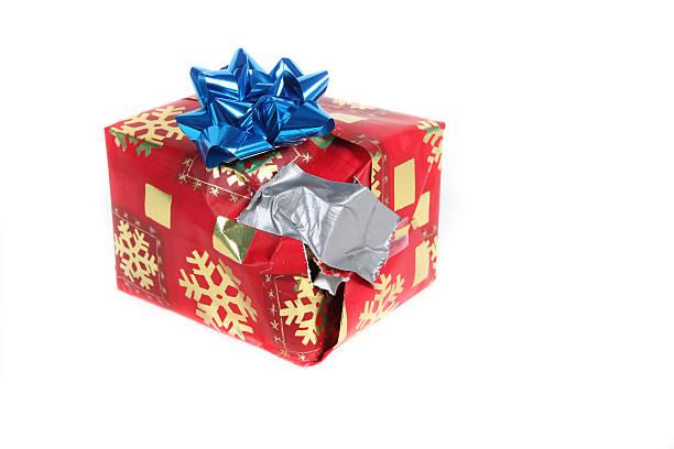 Bad  Christmas Gift  Present Paper Tape Sad Torn Leaking Liquid stock photo