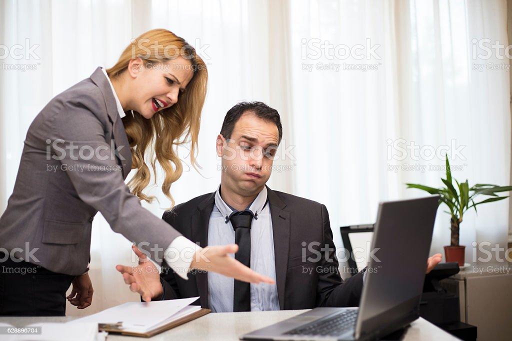 Bad comunication. Stress. Businesswoman Shouting at Businessman stock photo