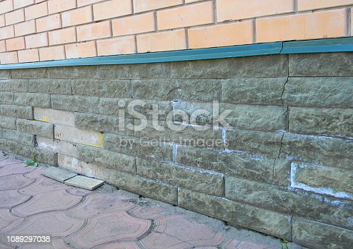 Bad condition of wet foundation walls. Mineral Efflorescence and foundation wall crack